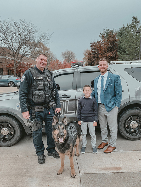 K9 Kubo his handler Officer Harmon, Brady from Brady's K9 Fund, and Geoff Senko from MMI